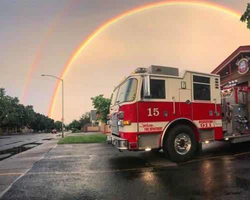 Spokane Fire Truck Parked under a rainbow